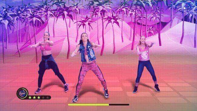 Screenshot del videogioco Zumba Burn it Up! che raffigura tre presenter che stanno facendo una coreografia. La presente in prima linea è la ragazza raffigurata sulla copertina del videogioco
