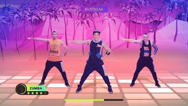 Screenshot del videogioco Zumba Burn it Up! che raffigura due presenter insieme a Beto Perez che stanno facendo la coreografia di Azukita